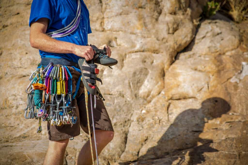 Rock climber with harness